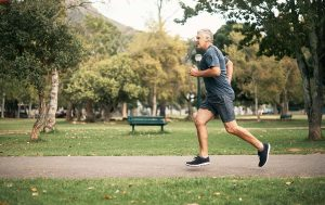 man running in park after starting testosterone replacement for low T