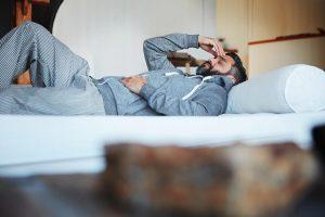 tired man lying down needs sleep apnea treatment