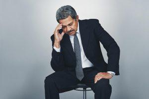 man falling asleep in chair needs sleep apnea treatment
